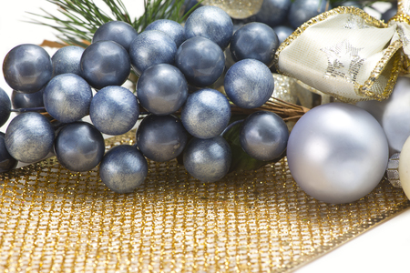 gold christmas decorations: Blue, gold, and silver Christmas decorations on white background. Stock Photo