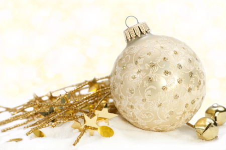 Gold tree ornament with gold decorations and bells on white background. Stock Photo