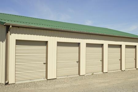 Green and beige outdoor self storage units. Archivio Fotografico