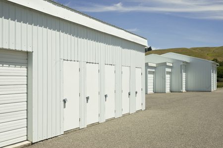 self storage: Blue and white outdoor self storage units. Stock Photo