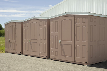 self storage: Beige and white outdoor self storage unit sheds.