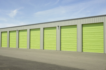 storage units: Green and gray outdoor storage units.