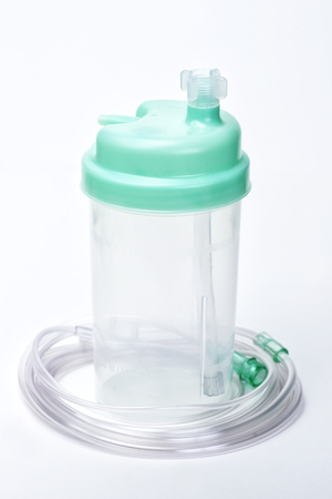 humidifier: Oxygen therapy system humidifier bottle with tubing.