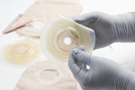 ileum: Nurse prepares ostomy supplies for use with patient.