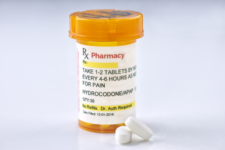 opioid: Hydrocodone prescription bottle.  Hydrocodone is a generic medication name and label was created by photographer.