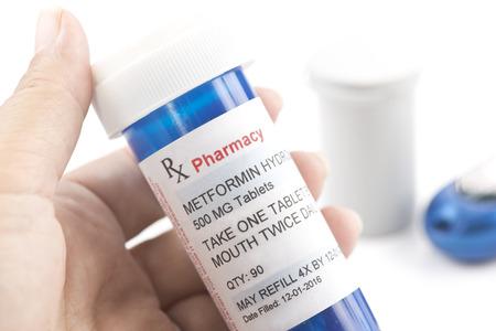 metformin: Metformin prescription bottle.  Metformin is a generic medication name and label was created by photographer.