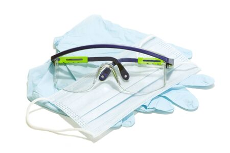 Gloves, mask and goggles for personal protection on white background.