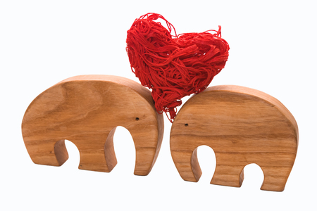 Elephant figurines support together a red decorative heart