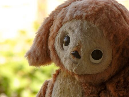 Old toy - plush Cheburashka. Vintage Russian artifact. Subject from the past.