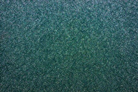 Beautiful shiny emerald surface with a fine pattern. Cover of an old book.
