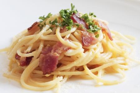 spaghetti dinner: spaghetti carbonara on white backgrounds Stock Photo