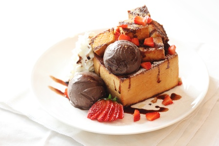 toasted bread and chocolate ice cream with strawberries topping horizontal photo
