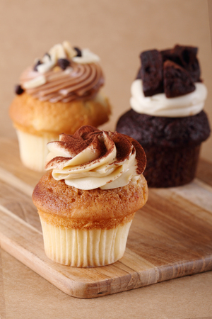 frosting': Three Homemade Cupcakes with swirl frosting and brownies