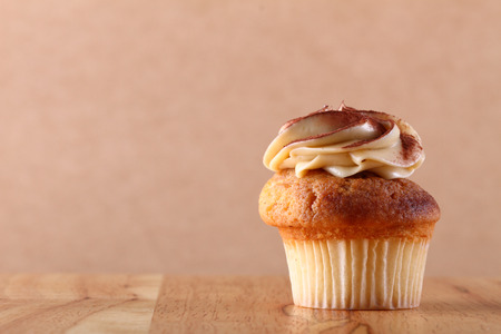 frosting': cupcake with frosting on wooden plate Stock Photo