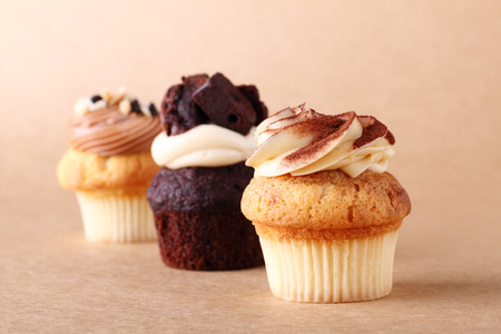 frosting': cupcakes with frosting on plain background