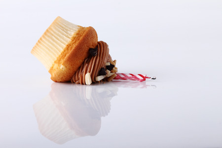 collapsed cupcake on white background