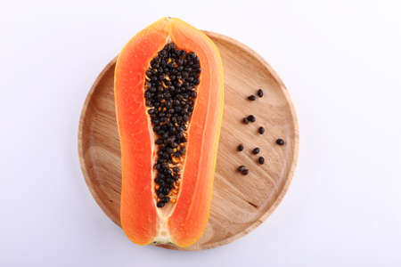 cranny: chop of papaya on wood plate Stock Photo