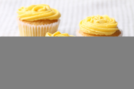 three cupcake frosting with buttercup color buttercream