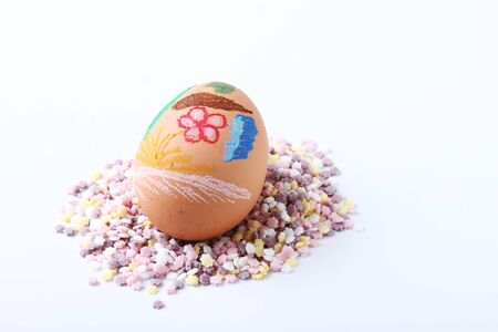 Easter egg put on pastel pretty candy  on white background photo