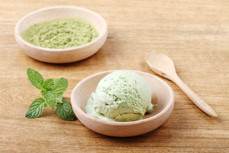 green tea ice cream in wooden small bowl Stock Photo