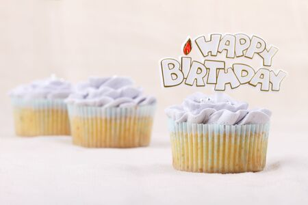 vanilla cupcake: vanilla cupcake frosting with buttercream, flower shape, decorated with happy birthday label