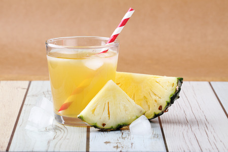 sliced pineapple with a glass of pineapple juice Foto de archivo