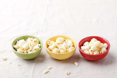 popcorn bowls: caramel popcorn in bowls on table with napkin