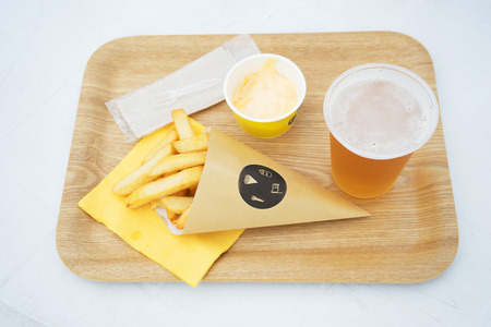 take away: Fried potato and beer in take away containers Stock Photo