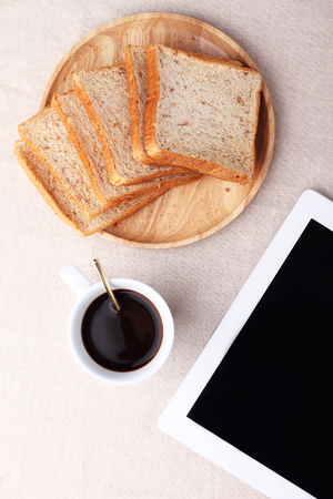 blank tablet: Digital tablet with blank screen with black coffee