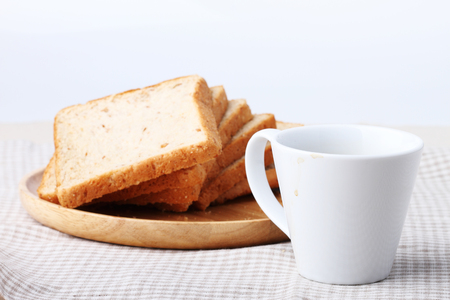 whole wheat: black coffee with whole wheat bread for breakfast Stock Photo
