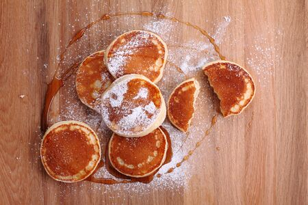 spread sheet: pancakes with syrup and powdered sugar