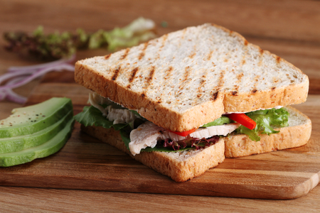 rocket lettuce: Sandwich of whole wheat bread with chicken and avocado