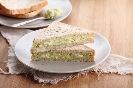healthy avocado egg salad fill in  whole wheat sandwich bread for breakfast