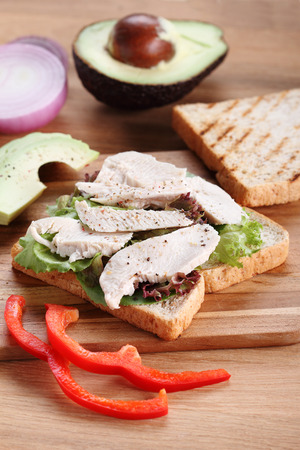 whole wheat: Sandwich of whole wheat bread with chicken and avocado