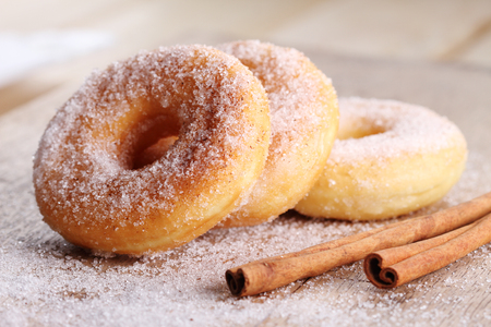 Sweet pieces of sugar doughnuts with cinnamon sugar Stock Photo