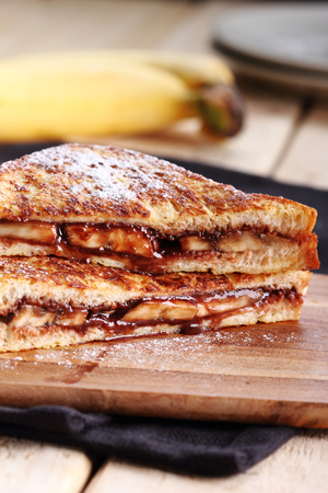 butter icing: chocolate banana french toast with whole wheat bread Stock Photo
