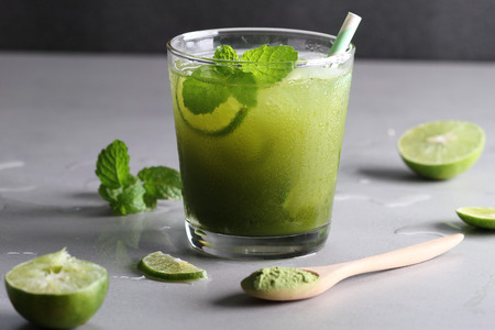 water on leaf: iced green tea with lime and fresh mint Stock Photo