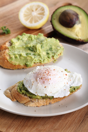 wheat toast: Breakfast, poached eggs with avocado salad on toast