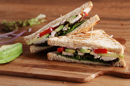 Sandwich of whole wheat bread with chicken and avocado