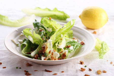 new vegetarian caesar salad with oat croutons Stock Photo