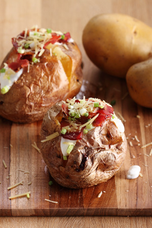 hot baked potatoes topped with bacon, cheese and soured cream