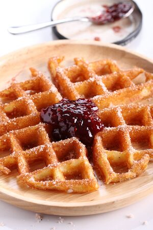 raspberry jelly: waffles cinnamon sugar top with raspberry jelly on wooden plate Stock Photo