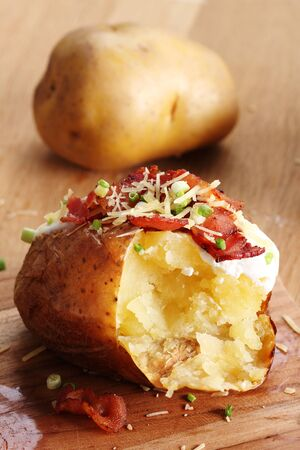 soured: hot baked potatoes topped with bacon, cheese and soured cream