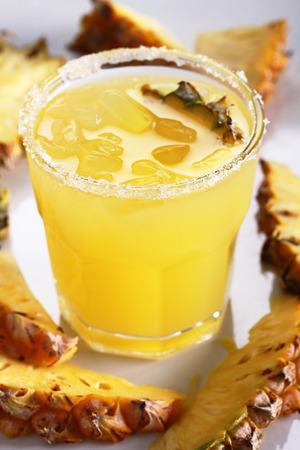 pineapple  glass: Fresh pineapple juice in the glass with slice Stock Photo