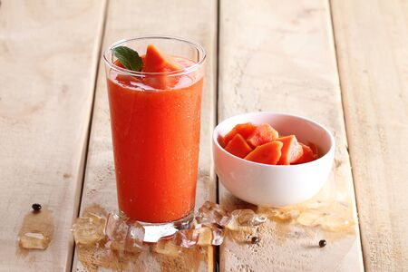 healthy fruity smoothie with papaya in a glass