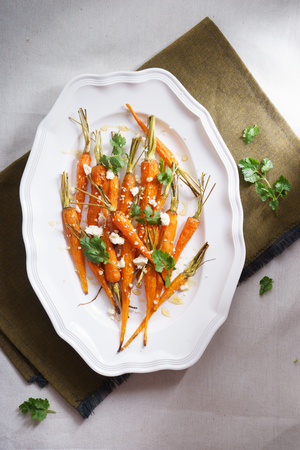 roasted sesame: roasted baby carrots with sesame and feta cheese Stock Photo