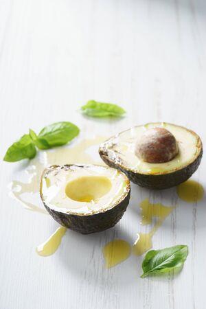 taint: fresh avocado cut half  with defect