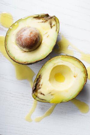 flaw: fresh avocado cut half  with defect