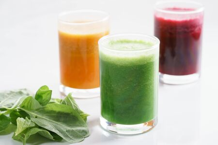 clean food: Fresh colorful healthy smoothies made with organic fruits and vegetables in glass Stock Photo