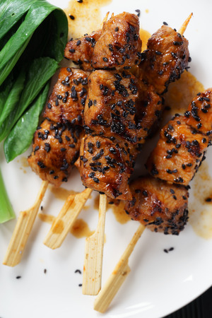 kabab: sesame beef skewers with green vegetable Stock Photo